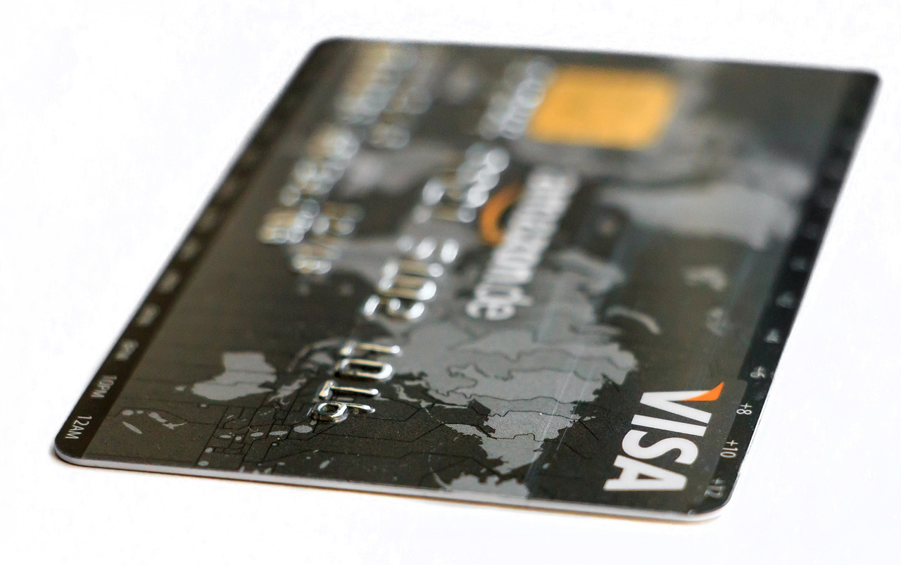Black Visa card with world map background