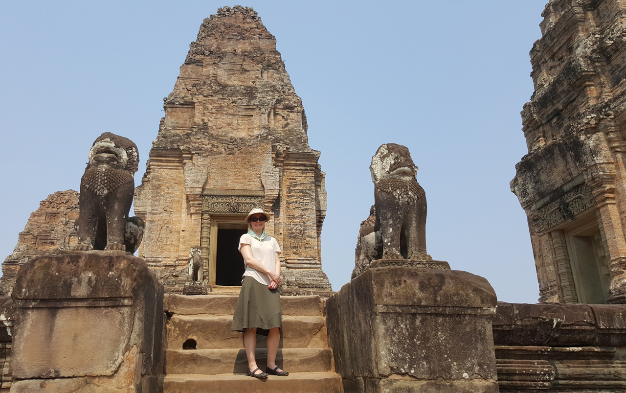 Woman standing in front of a temple