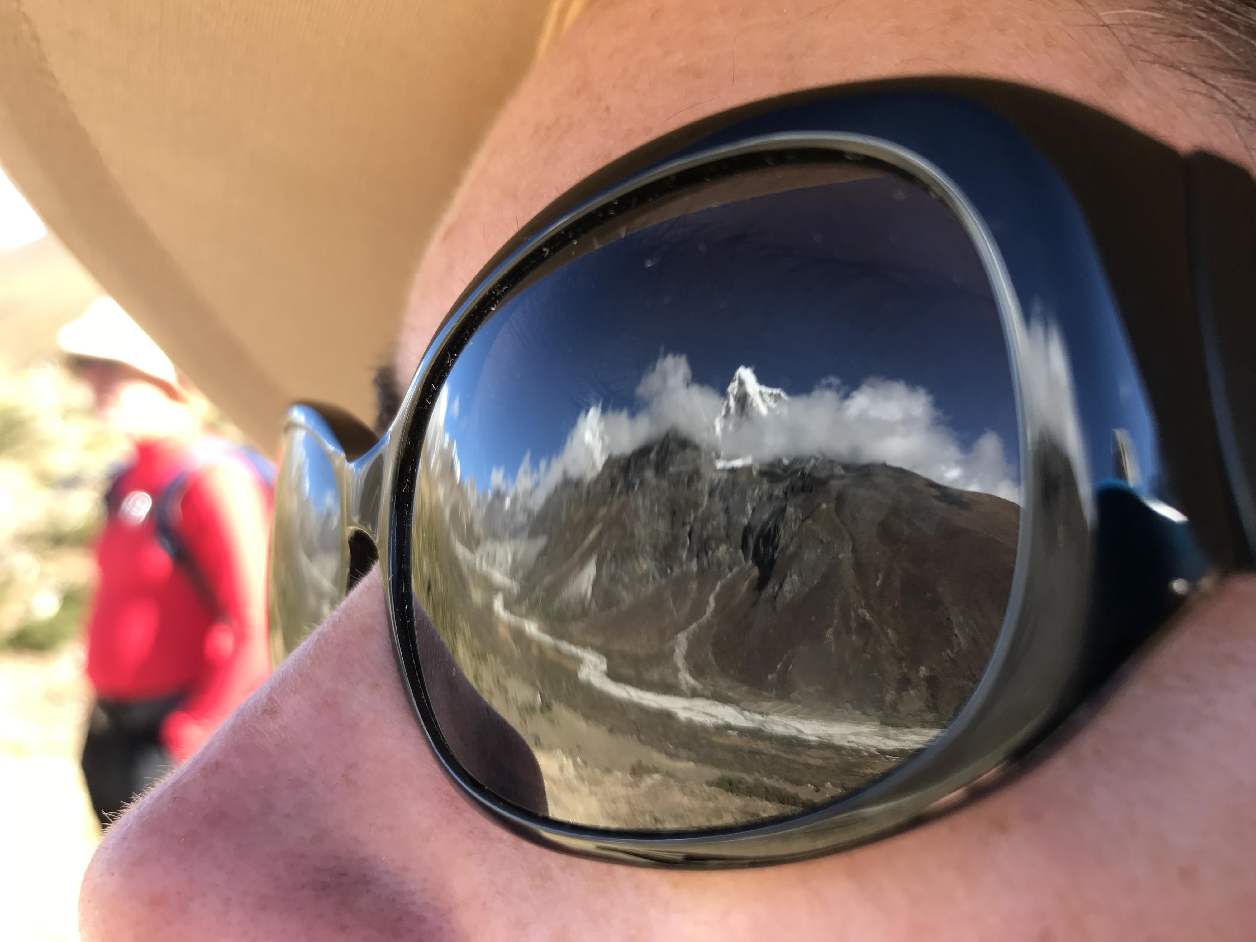 Mountain reflection in sunglasses