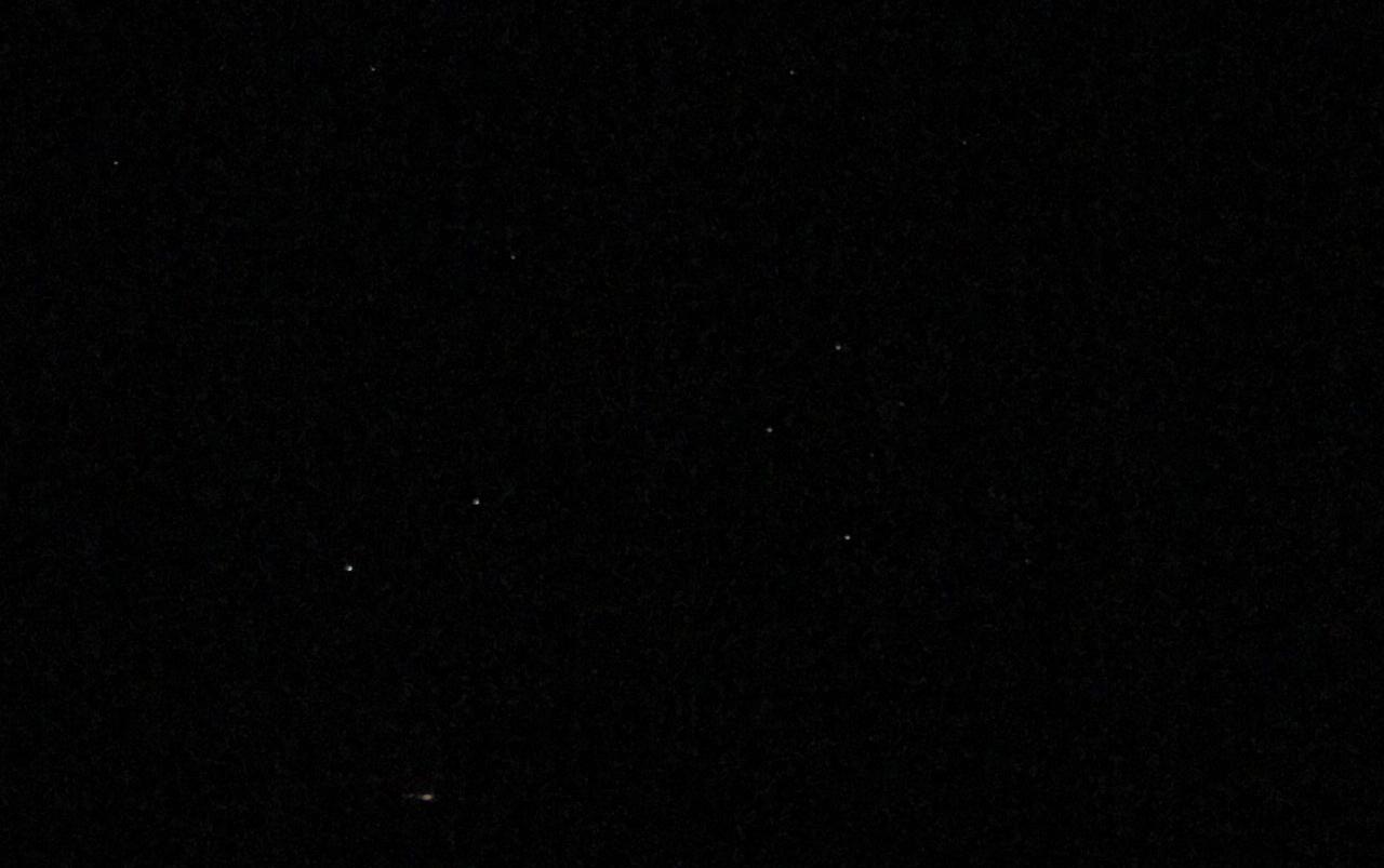 White stars against a black sky