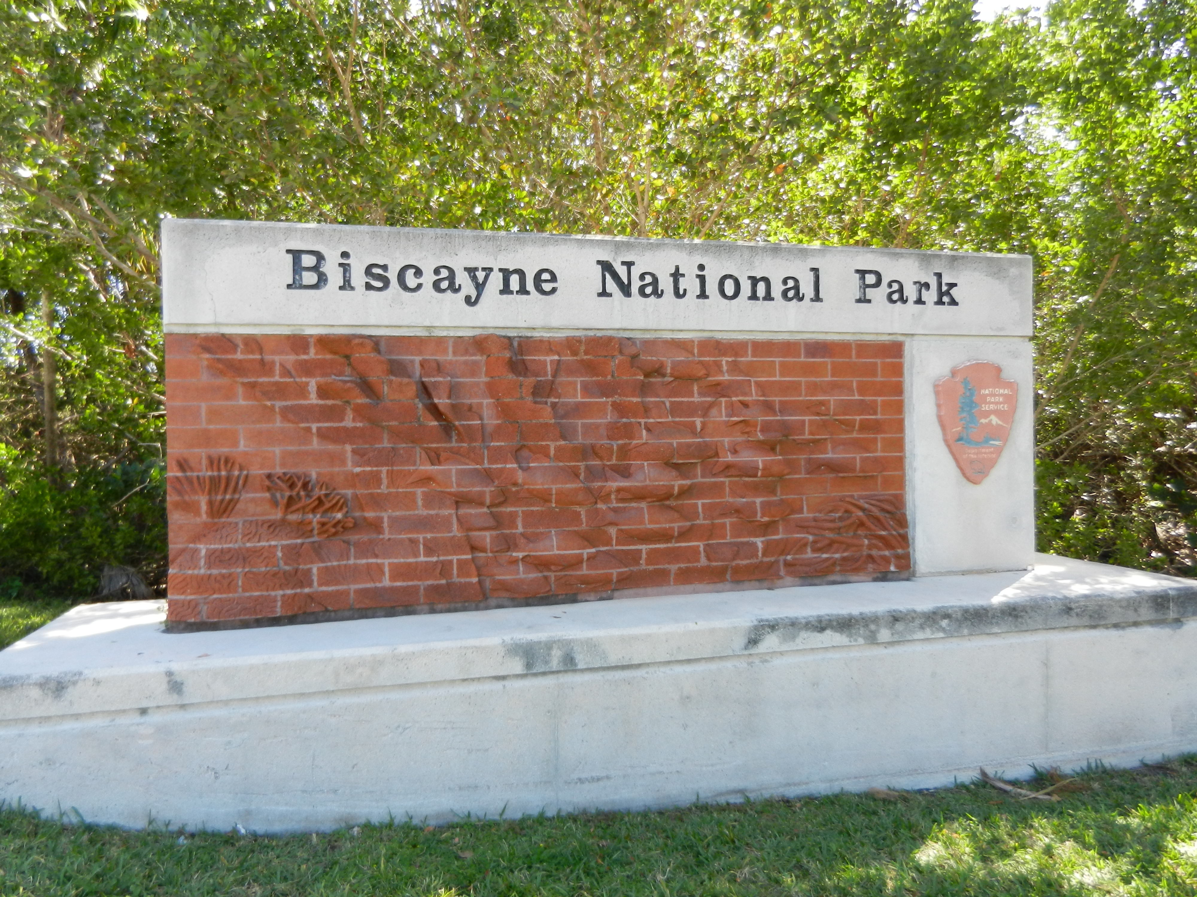 Biscayne National Park sign with sculptural relief of fish.