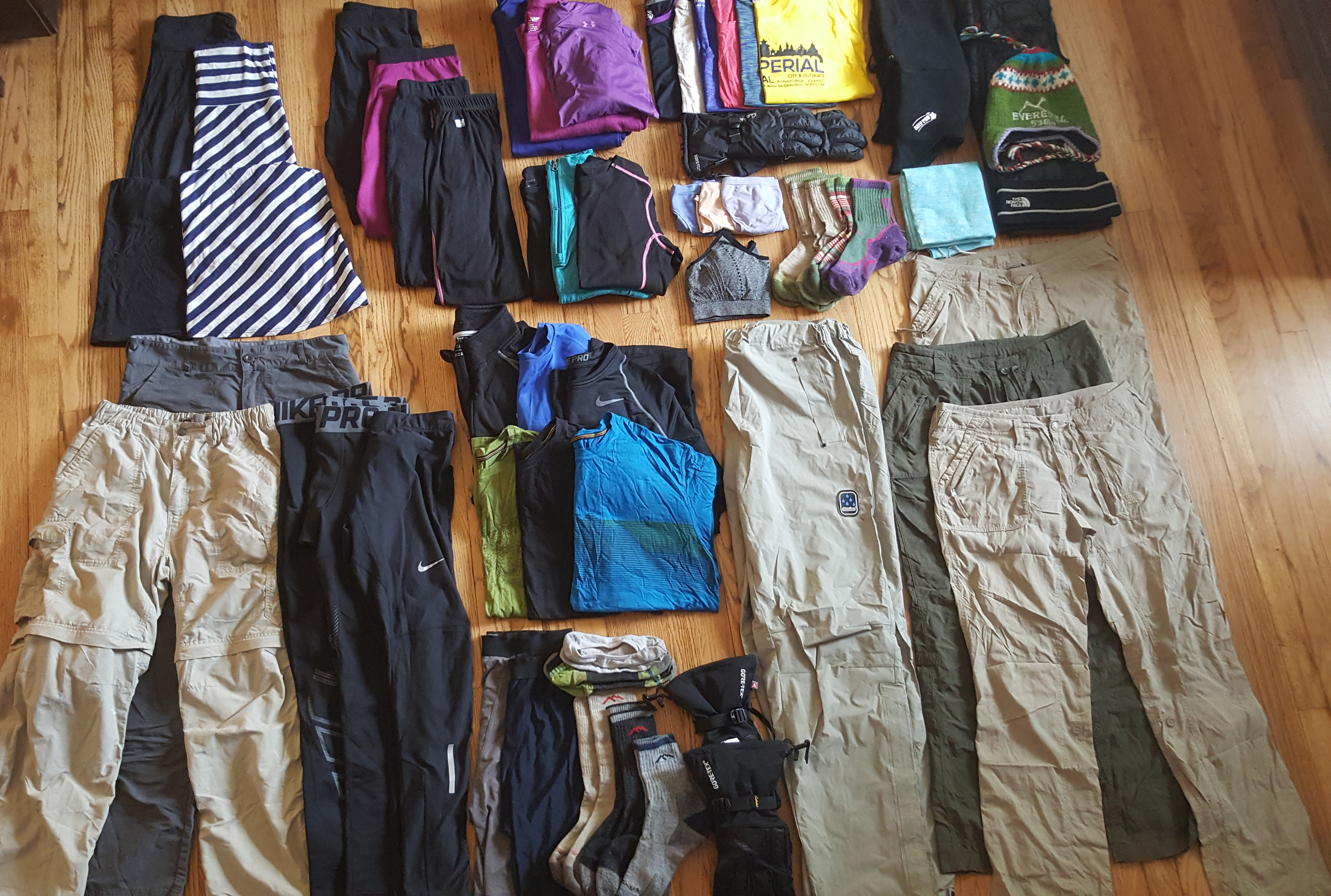 Clothing items laid out in an orderly fashion on the floor.