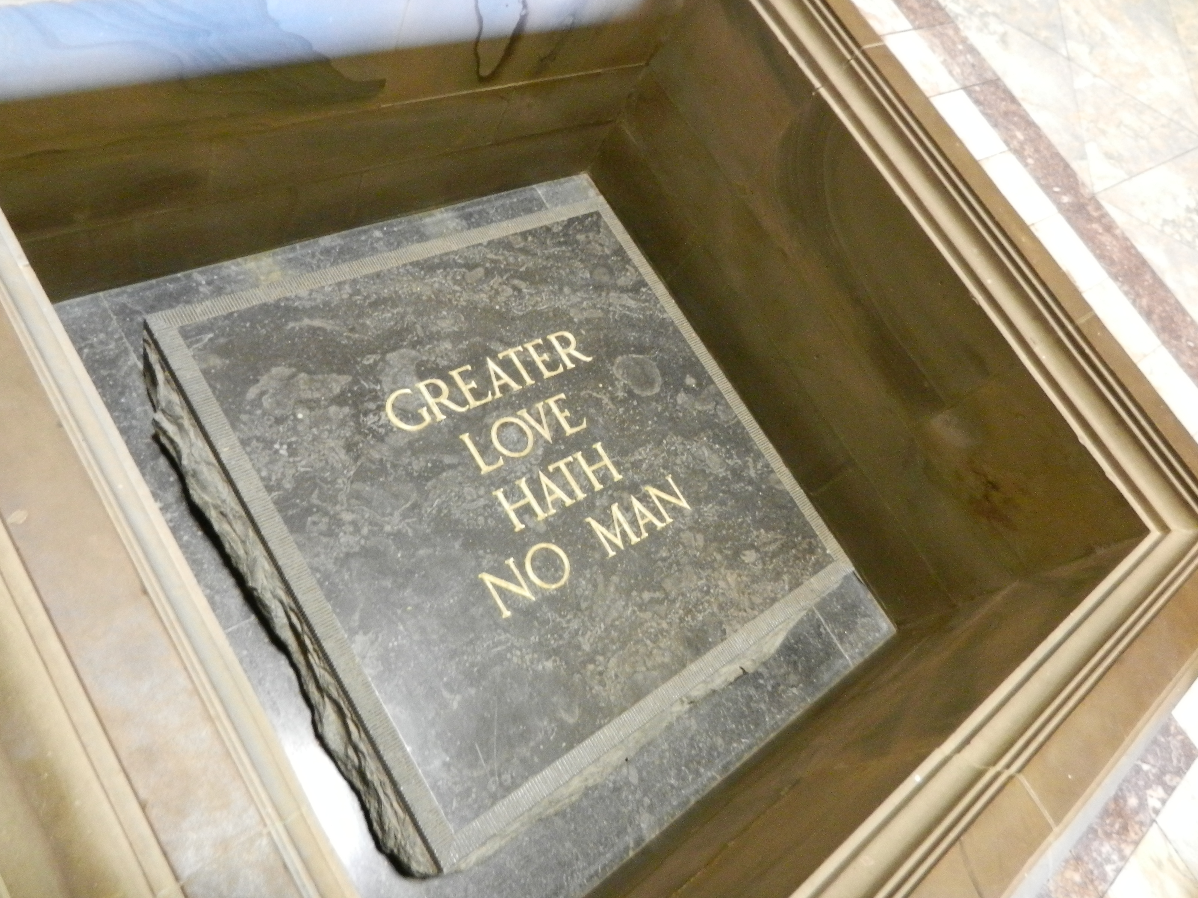 """Square stone monument that reads """"Greater love hath no man""""."""