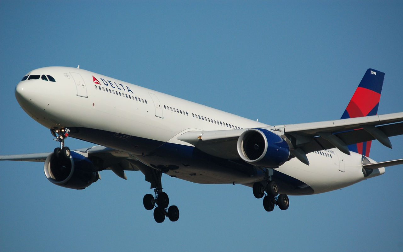 Delta airplane flying in the sky.