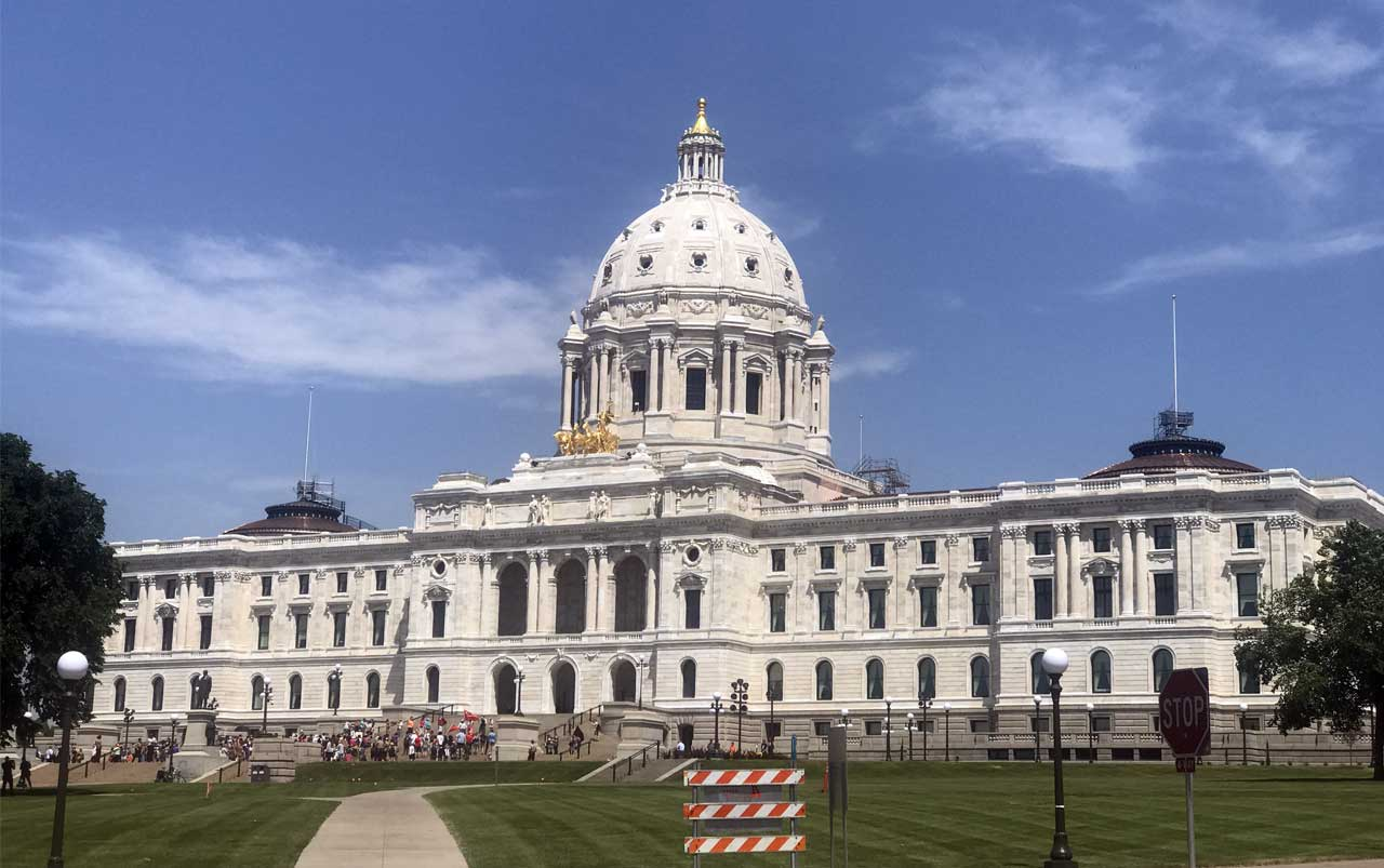 Minnesota State Capitol building with protestors congregated in front. Photo taken from the southeast corner.