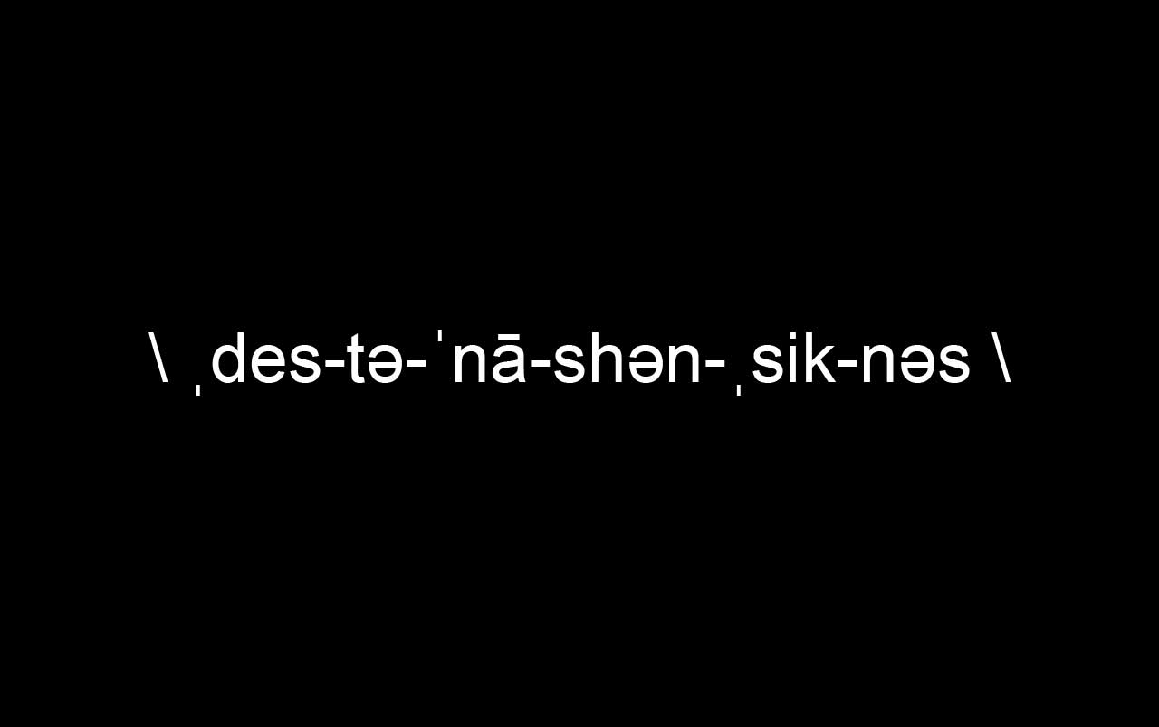 Black background with white text spelling out the phonetic spelling of destination sickness.